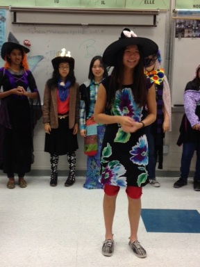 """Sophomore Emily Wang, participator in the Paris Fashion Show Inspired Costume Contest, poses for the judges on September 25, 2013.  """"It was a fun event,"""" Wang said. """"I got to try on different things."""""""