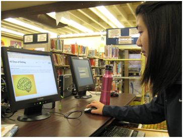 Junior Amy Chang reads the entries on the 40 Days of Dating website on October 10, 2013. The website features graphic design pieces for each entry and also includes various gifs and videos. PC: Priscilla Ng