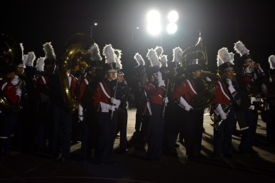 "American High School's marching band has a quick run-through before performing their last show. Putting on their game-faces, they walked out confidently onto the field.  ""A lot of us put our whole hearts into our last performance,"" junior Kate Beddingfield said."