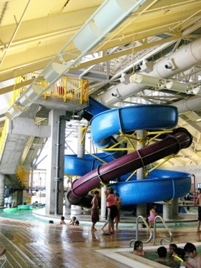 """Silliman Center has two large water slides that drop into a four feet deep pool. The tower rises twenty feet above the pool deck. One slide is a full chute and the other slide is a half chute. """"It is like a mini indoor waterpark in their,"""" senior Sabah Khokhar said."""