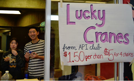 """Seniors Lemi Mochinaga and Roger Lee sell cranes on Thursday, February 6.  API club officers all came up with the idea to sell chains of cranes collaboratively. """"Cranes are really pretty and decorative,"""" sophomore Denise Kuo said. """"It was a cute way to connect to the Chinese New Year that just passed and also with Valentine's Day."""" // PC: Navy"""