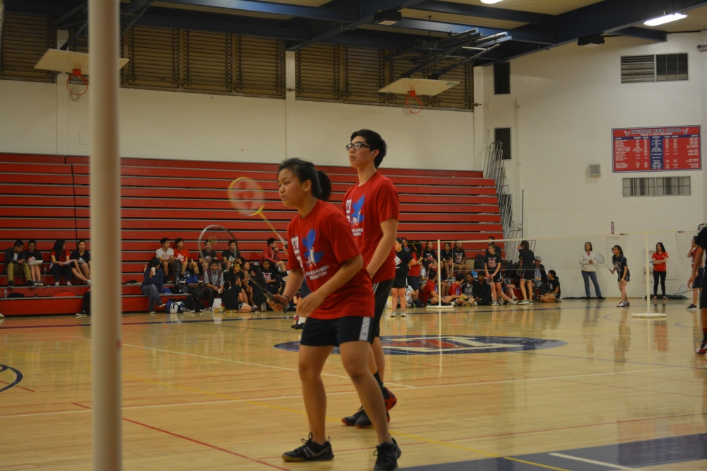 """Junior varsity badminton players battle hard against James Logan High School. While they lost, the team used the failure as a sign to work harder and win the rest of the season. """"The best players on the team are the ones who train the most and care the most,"""" Coach Anh said."""
