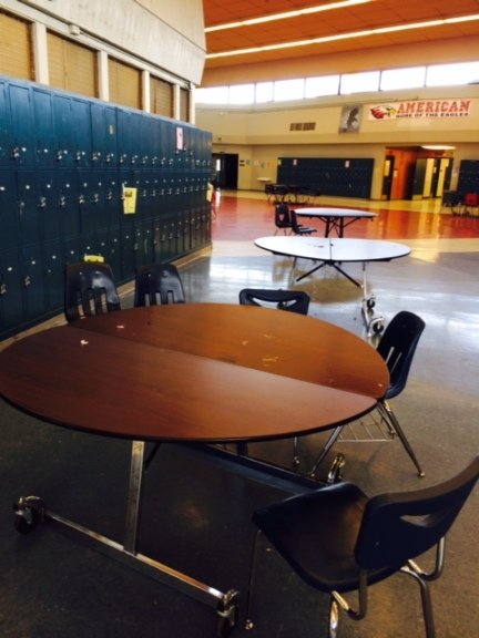 "Caption: Three of the tables in the rotunda that have a total of 7 chairs between them. ""Getting chairs and table at lunch is very difficult because everyone is fighting for them,"" senior Sabrina Van Eyck said. ""I wish they would set out more chairs and tables in the rotunda"". PC: briana hill"