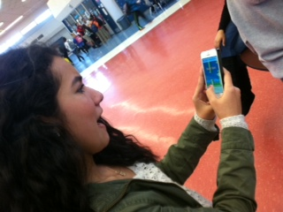 """This game makes me so mad,"" sophomore Khaterah Sayed said. Playing flappy bird trying to pass time sure looks like its working out for her. "" It passes time and it gets really addicting can't really stop playing."""