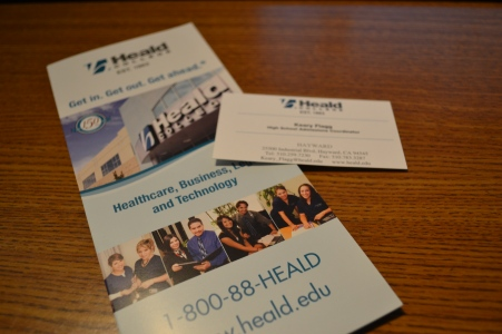 "The Heald College pamphlet sits alongside the representative's business contact card on an isolated table. Representative Flagg left information in the Career Center for students who missed out on the presentation, or students can visit www.heald.edu for more information about the college. ""We have special scholarship offers for incoming high school graduates,"" Flagg said. ""They go up to about $2100. We also offer tours where they can meet with certain people and discuss some of their interests."""