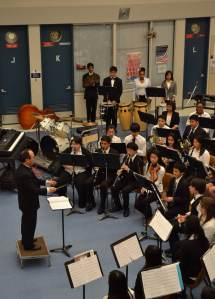 "Music and choir teacher Mr. Wong conducts one of the first of many numbers performed by the Concert Band. The student performers poured all their efforts into the production as the music echoed around the entirety of the rotunda. ""Each instrument gives me an adrenaline rush, like when I'm playing mallets and I'm able to play some 16th note run well,"" Hsiao said. ""Or when I'm playing violin and there's a note I'm holding out that's perfectly in tune that fits amazingly with the rest of the band!"""
