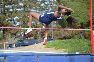 "Senior Shanelle Swamy clears the high jump. The varsity girls swept in both the 100 meter sprints and the long jump. ""Even though the team did well this year, I'm really hoping that more people will join track next season. We need more serious athletes on the team,"" Shing said. PC: Karen Ku"