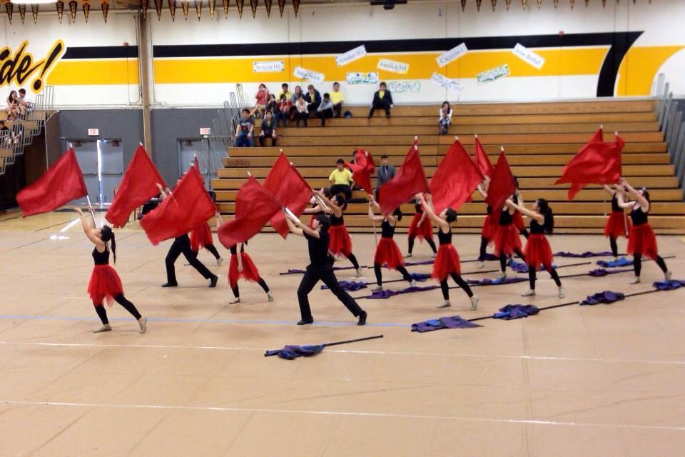 "The Winter Guard performs their routine to ""Gravity"" at Granada High School in Livermore.  This was the second of two of the competitions both the guard and percussion went to on Saturday, March 15, 2014.  ""This competition gave the first-time members an idea of what competitions are like,"" senior Molly Farmer said.  ""Now that everyone knows what to expect, we can do even better at our next competition this Saturday [March 22]."" PC: Leesa Choy"