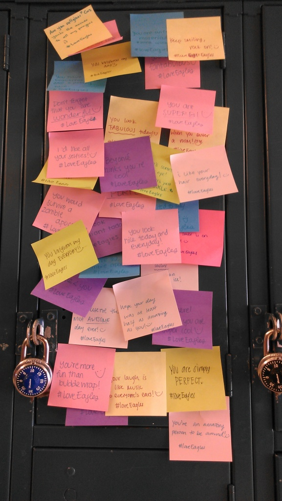 """One of the many lockers in the rotunda is covered from top to bottom with loving messages. As the week began to come to a close, the school began to feel its positive reinforcement grow. """"Personally, I liked compliment day the most because every locker had a post-it note with a compliment written on it,"""" junior Malvika Brahmbhatt said. """"When we all walked out of fourth period block on Thursday, tired and waiting for Friday to finally come, we were greeted by so many colorful notes and I think everyone smiled to themselves when they read the note on their own locker."""""""