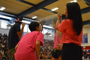 "Seniors Kayure Patel and Dana Acoba hold the glass plate as senior Justin Wei and sophomore Felicia Lin participate in the Nutella/Oreos game. Lin was declared the winner of this round, as there were three other games occurring at the same time. ""I think Battle of the Sexes Week went well overall,"" Yen said. ""It's a kind of fun thing to have around, especially right before AP testing so you can relieve some stress and have fun dressing up with friends."" PC: Priscilla Ng"