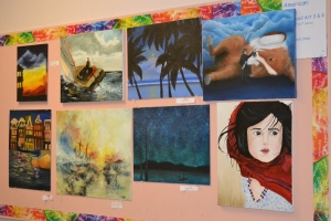 "Students' art pieces are displayed at the District Art Show on April 15, 2014 from 5-8PM. Most of the selected students had never been chosen to participate before. ""Each students' work was unique in their own way and showed so much talent! I really felt honored that I qualified [to participate],"" junior Kristy Hong said.  P"