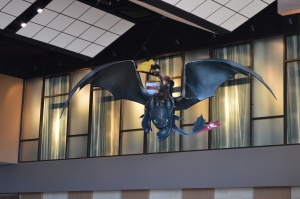 A cutout of Hiccup and Toothless, advertising How to Train Your Dragon 2, hangs from the ceiling of the Century Theaters in Pacific Commons. The movie features actors Jonah Hill, Kristin Wiig, and Kit Harrington. It will be released June 13, 2014.