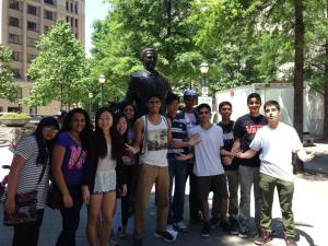 "The DECA members pose in front of a statue as they explore the city of Atlanta. When the DECA members were not busy competing, they were able to travel around to different tourist attractions and restaurants the city had to offer. ""I'm going to miss them all when I graduate, but the memories we shared will be one of best things about my high school experience,"" Kapshikar said. ""Next year, I know that the team will achieve more competitive success and make many more inspiring, motivational, exciting, and just plain silly, memories."" PC: Katherine Cui"