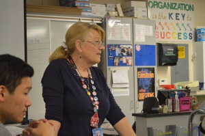"Mrs. Sykes discusses the materials and procedures of a lab with her AP Chemistry students.  Though she has been teaching both Honors and AP Chemistry for many years, when she first arrived at AHS in 1996, she also taught Integrated Science, which included Earth and Physical sciences.  ""I started teaching here when the seniors were born, so we are all graduating together,"" Mrs. Sykes said. PC: Caroline Lee"