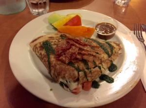 The Buffalo Crepe is complemented with bacon strips and pesto sauce on the top, and buffalo sauce on the side to give it a spicy, hot taste. Some fruits are also provided to soothe your mouth after a burning, hot sensation from the buffalo sauce.