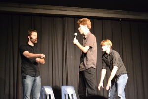 Ben Stevens and Sean Taylor act out an improvised Shakespeare scene on the spot with some help from senior Trevor Broberg. PC: Megumi Kamikawa.
