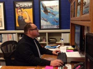 Mr. Musto works in his office in gateway.