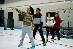 """Seniors Keani Turangan, Sean Acidera, Megan Chinn, and Emmy Lancandazon perform a self-choreographed routine at the Interact Area 4 Benefit Showcase. The crowd reacted well to the team's innovation. """" The aerials and flips always get a good reaction from the crowd, people in the air just seem enjoyable to everyone,"""" Lacandazon said.  PC: Jessica Huynh"""