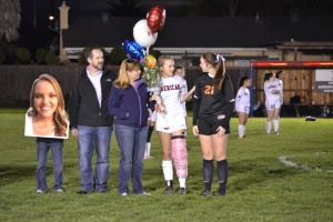 "Zack, Morgan, Michelle, and Rhianna Soares (12), and her best friend Chloe Lambert line up with the rest of the families during senior night on February 12, 2015 at American High School. ""I was extremely happy and excited for the game, but knowing [that] it was my last [game] gave me mixed emotions of happy and sad,"" Soares said."