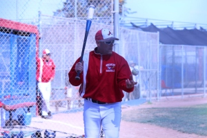 American's new varsity head coach, Steve Jespersen, hits infield to his team before the American v. Newark Memorial game held on April 24, 2015. The addition of Jespersen marks American's first new varsity head coach in over a decade.
