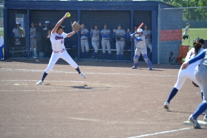 Kalani Taylor (11) starts the game off delivering a strike against Newark Memorial. The game was held on April 16th, 2015 at American's softball field, where American lost by a final of 5-0.
