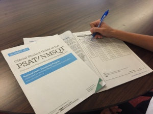 "The new PSAT was administered on Wednesday, October 15 and taken in various classrooms of American High School. The student shown above works on the PSAT Official Student Guide to practice for the test. ""The PSAT is really helpful,"" sophomore Kavi Kanax says. ""It provides a good opportunity for practice."""